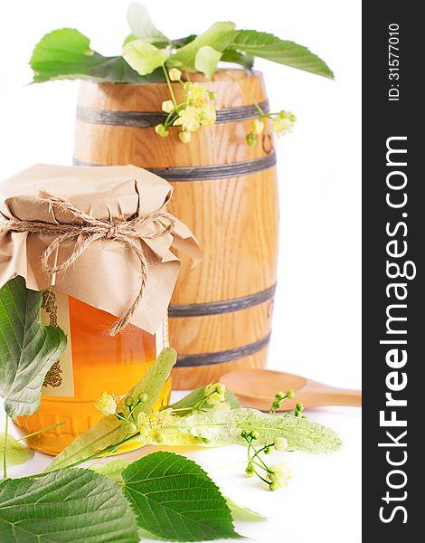 Linden honey jar and barrel with flowers
