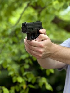 Free Aiming A Semi-Automatic Handgun Stock Photography - 31597362