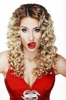 Provocative Classy Blond Licking Her Red Lips Stock Images