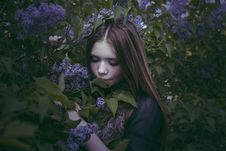 Beauty Young Girl In Fashion Style Smells Lilac Flowers Outdoors Stock Images