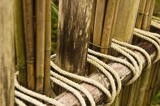 Free Rope Tied To A Bamboo Fence. Royalty Free Stock Photos - 31642428