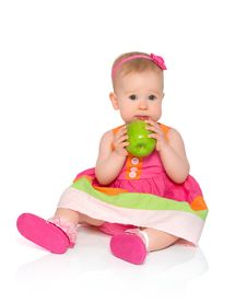 Free Happy Little Baby Girl In Bright Multicolored Festive Dress With Royalty Free Stock Image - 31642476