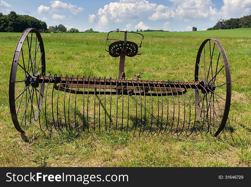 Rusty harrow plow back