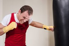 Free Man Makes Exercises With Punching Bag Royalty Free Stock Photos - 31657748
