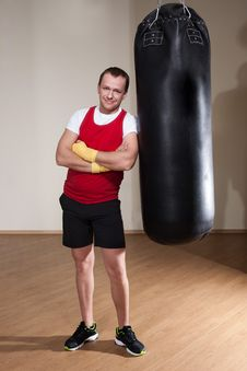 Free Man In Boxing Gloves With Punching Bag Stock Image - 31657751