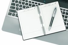 Notepad And Pen On A Notebook Keyboard Royalty Free Stock Images
