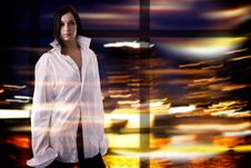 Pretty Woman In White Shirt Over Colorful Blurred Lights Background