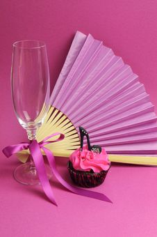 Free Pink Party Decorations With Fan, Champagne Glass And High Heel Shoe Cupcake - Vertical. Royalty Free Stock Photo - 31678385
