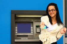 Woman At An Atm Royalty Free Stock Image