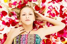 Free Young Girl Lies In The Petals Of Roses Stock Photos - 31680123
