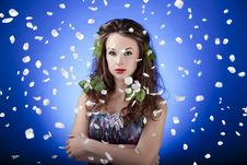 Free Gorgeous Girl With Flowers In Hair And With Flying Petals Around Stock Image - 31681481