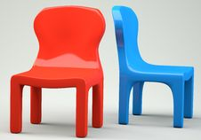 Red And Blue Cartoon-styled Chairs Stock Photos