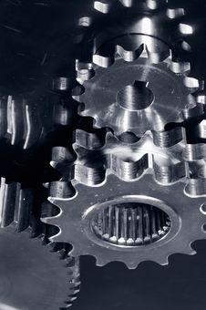 Silver Gears Against Titanium Stock Image