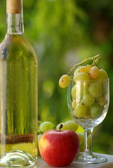 Bottle Of White Wine And Fruit Stock Photo