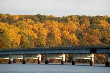 Fall Foliage, Water And Bridge Royalty Free Stock Images
