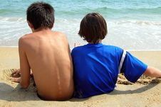 Free Two Boys-Sinking In The Sand Royalty Free Stock Image - 3179756