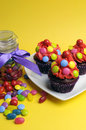 Free Bright Colored Candy Cupcakes With Candy Jar - Vertical. Royalty Free Stock Images - 31700479