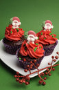 Free Three Christmas Cupcakes Against A Green Background - Vertical Stock Images - 31700874
