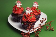 Free Three Christmas Cupcakes Against A Green Background. Stock Photos - 31700843