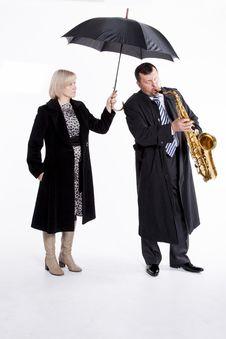 Free Saxophonist Under An Umbrella Royalty Free Stock Photos - 31704188