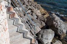 Free Stairs By The Mediterranean Sea With Rocks And Zigzag Shadow Pattern Stock Photo - 31710720