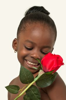 Free Beautiful Little Girl With Red Rose Royalty Free Stock Photo - 31734175