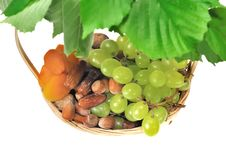 Basket Of Dried Fruits And Grapes Stock Photo
