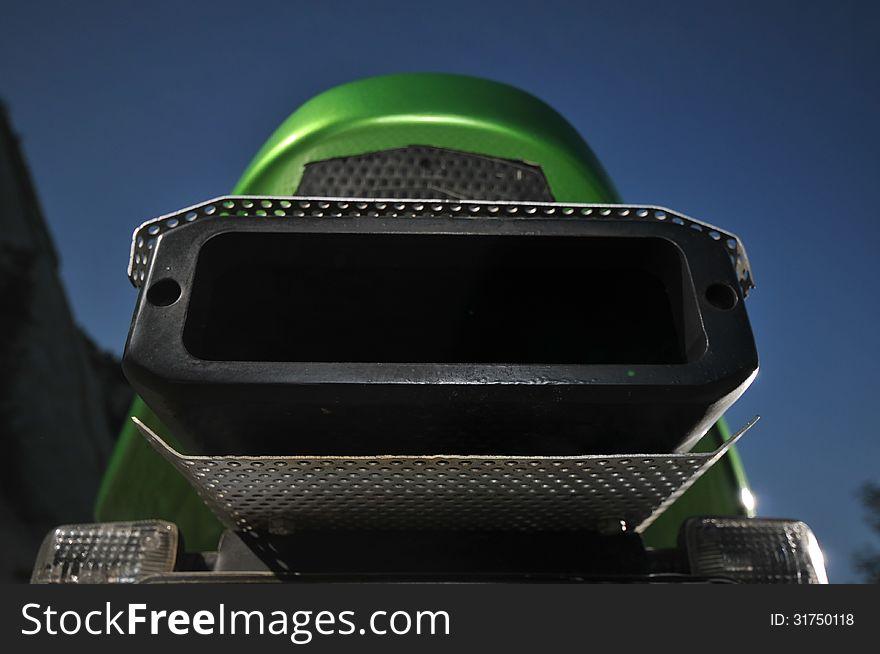 My green sport motorcycle  exhaust