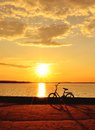 Free Bicycle By The Lake At Sunset Royalty Free Stock Photo - 31766535