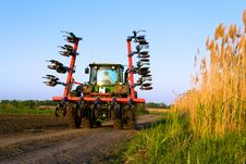 Free Tractor In A Field Royalty Free Stock Image - 31779356