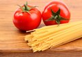 Free Tomatoesl And Uncooked Spaghetti Royalty Free Stock Photo - 31797815