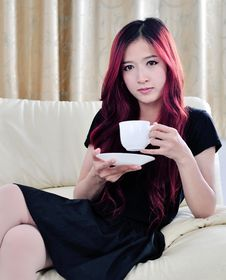 Free Beautiful Asian Women With Red Long Hair Drinking Coffee Stock Photo - 31797160