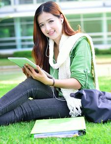 Free Asian Women Student Learning With Computer Tablet Royalty Free Stock Photo - 31797165