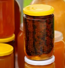 A Honeycomb And A Honey In A Glass Jar Royalty Free Stock Photo