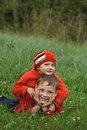 Free Two Brothers On A Grass Stock Images - 3182294