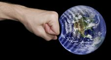 Fist And Earth Royalty Free Stock Photos