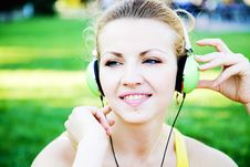 Free Young Cheerful Woman Enjoing The Music Outdoors Royalty Free Stock Images - 31824129