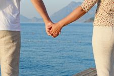 Free Loving Couple Holding Hands Royalty Free Stock Image - 31828636