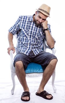 Bored Tourist Sitting In A Chair Royalty Free Stock Photos