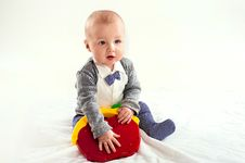 The Small Boy Plays With A Red Toy Royalty Free Stock Photos