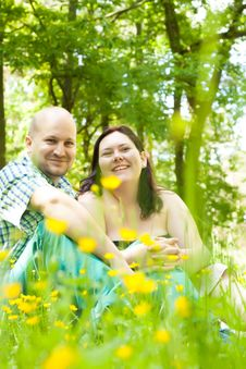 Free Happy Young Married Couple Between Flowers Stock Photos - 31850813