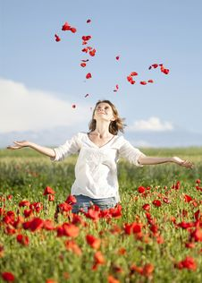 Free Girl Enjoying Summer In A Poppy Field Royalty Free Stock Photo - 31858245