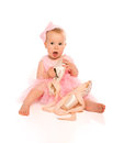 Free Little Baby Girl In A Pink Ballerina Dress With Pointe Shoes Stock Photo - 31868500