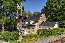 House At The Railway Crossing Stock Image
