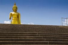 Big  Golden Buddha Statue On Blue Background. Stock Images