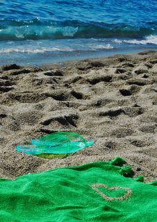 Free Flipflop And Towel In The Sand Royalty Free Stock Image - 31870436