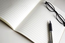 Free Blank Notebook With Pen And Glasses Royalty Free Stock Images - 31874299