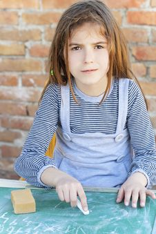 Free Little Girl Writing On Blackboard Royalty Free Stock Photography - 31879657