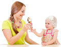 Free Mother Giving Ice Cream To Little Girl Sitting At Table Stock Photography - 31887322