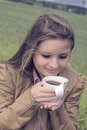 Free Girl Drinks Coffee With Pleasure Outdoors Royalty Free Stock Photo - 31892825